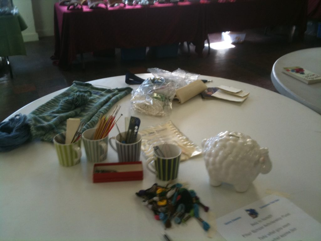 Our popular destash table, starring the Scholarsheep bank for donations.